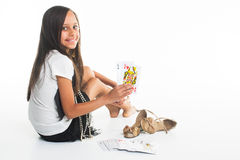 Little girl plays cards Queen of all Royalty Free Stock Photo