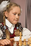 Little girl plays chess Stock Photography