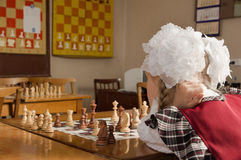 Little girl plays chess Stock Image