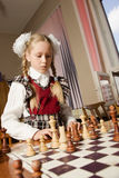 Little girl plays chess stock photo