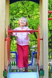 Little girl plays on the chidish hill Royalty Free Stock Photo