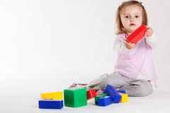 Little girl plays with cubes Royalty Free Stock Image