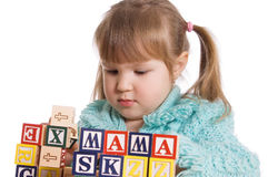 The little girl plays cubes Stock Image