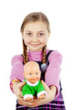Little girl plays with a doll Stock Photo