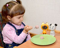 The little girl plays food time Royalty Free Stock Images