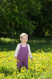 Little girl plays on a glade Royalty Free Stock Image