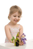 A little girl plays with gnomes Royalty Free Stock Photo