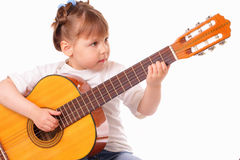 Little girl plays guitar Royalty Free Stock Photo
