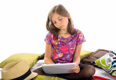 A little girl plays with her digital tablet Stock Image