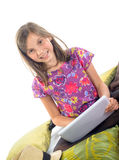 A little girl plays with her digital tablet Stock Images
