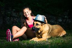 A little girl plays with her German shepherd dog.  royalty free stock images