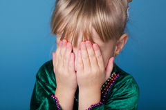 Little girl plays hide and seek Royalty Free Stock Images