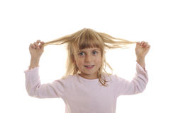 Little girl plays with his hair Stock Photo