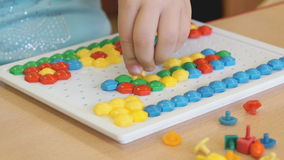 Little girl plays a intellectual educational game stock footage
