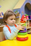 Little girl plays in kindergarten Stock Photography