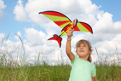 Little girl plays kite on meadow Royalty Free Stock Image