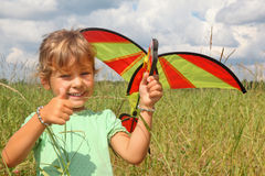 Little girl plays kite on meadow with ok gesture Stock Photography
