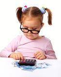 Little girl plays with money Stock Images