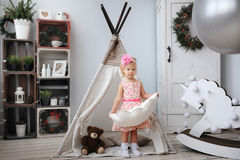 The little girl plays in the nursery. Royalty Free Stock Image