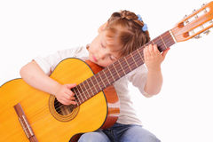 Little girl plays an old guitar Royalty Free Stock Photo
