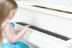 Little girl plays the piano. Royalty Free Stock Photography