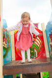 Little girl plays in playground Stock Photo