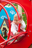 Little girl plays in playground Royalty Free Stock Image