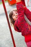 Little girl plays in playground. In a park Stock Image