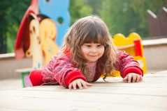 Little girl plays in playground Stock Photos