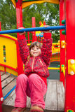 Little girl plays in playground Stock Photography