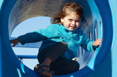 Little girl in playground Royalty Free Stock Image