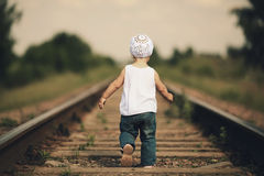 Little girl plays on railroad Royalty Free Stock Photo
