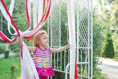 Little girl plays with ribbons in the park Royalty Free Stock Photos