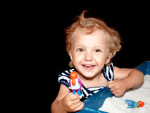 Little girl plays in sand Royalty Free Stock Photo