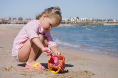 Little girl plays on seacoast Stock Photo