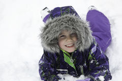 Little Girl Plays in Snow Royalty Free Stock Photography