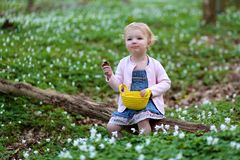 Little girl plays in spring forest at Easter Royalty Free Stock Image