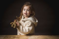 Little girl plays with a straw bear Royalty Free Stock Images