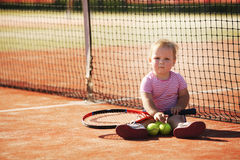 Little girl plays tennis Stock Images