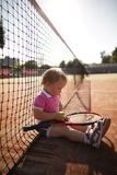 Little girl plays tennis Stock Photo