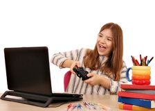 Little girl plays a video game Stock Image