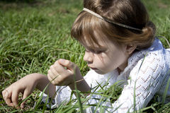 The little girl plays in the village stock photography