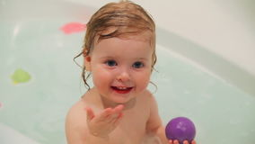 Little girl plays in the water stock video footage