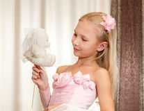 Little girl plays with wedding teddy-bear Royalty Free Stock Photography