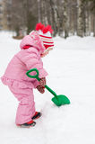 The little girl plays in the winter Stock Image