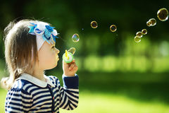 Little Girl Plays With Bubbles Stock Image