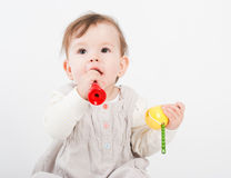 The little girl plays with wooden toys Royalty Free Stock Photo