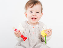 The little girl plays with wooden toys Stock Image