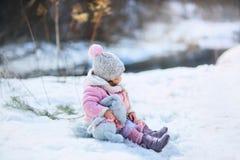 Little girl with plush bunny Stock Photos