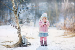 Little girl with plush bunny Stock Image